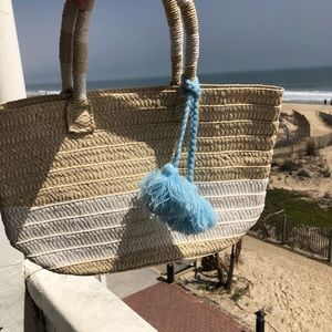 ALTRU Made For Good straw bag with tassels